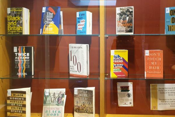 A display case filled with books about Black history and related topics