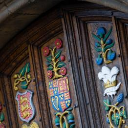 Close up of the wooden gates of Oriel College Oxford