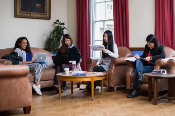 Photo of postgraduate students in the MCR
