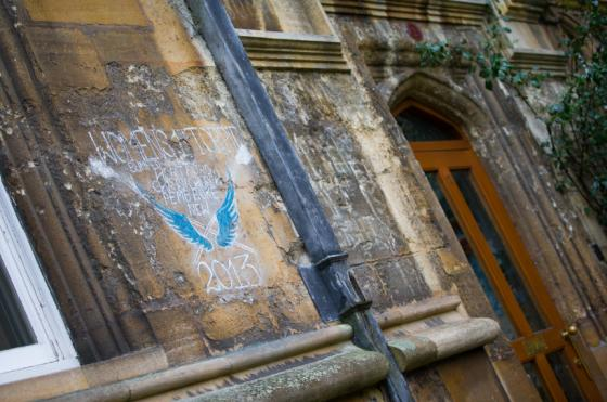Image of chalk on the walls in Oriel's front quad