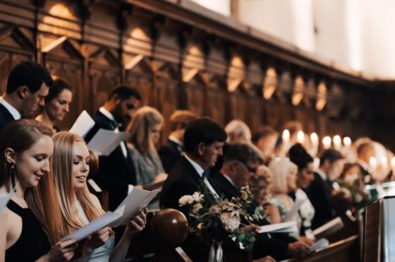Guests at a wedding in the Oriel College chapel