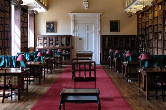 Oriel College Senior Library interior with desks and antique books