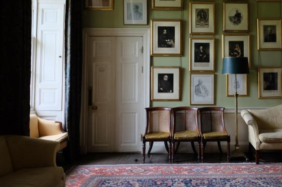 The Oriel College Senior Common Room, which has many portraits all over the walls