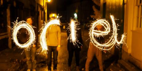 The word 'Oriel' spelled out by sparklers in the dark