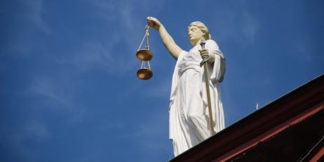 Image of a statue of Lady Justice holding the scales of justice