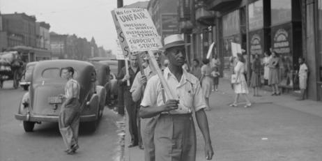 Striking workers picketing a reality company in New York ca. 1936-42