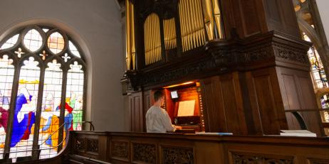An organist playing in the Oriel college chapel