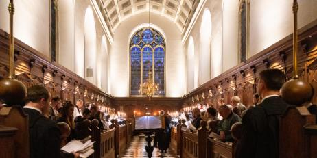 Oriel College Chapel during a candlelit evensong service