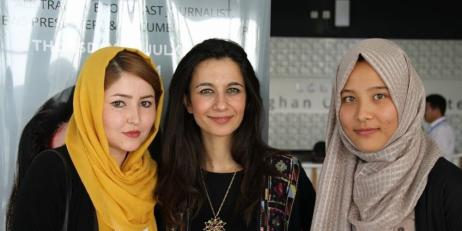 Yalda Hakim with two young Afghan women