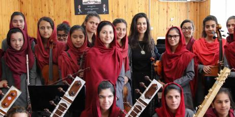 Yalda Hakim with young female musicians in Afghanistan