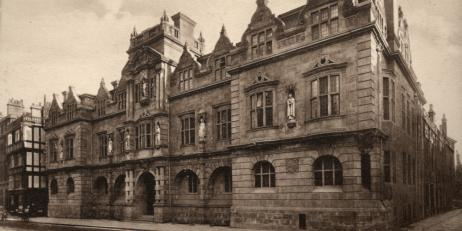Black and white photo of the Cecil Rhodes statue on a building belonging to Oriel College on Oxford's High Street