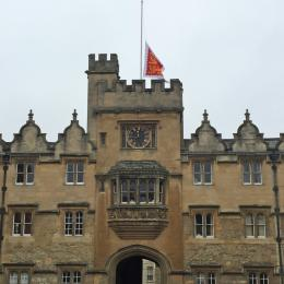 The Oriel College flag flying at half mast from the main tower