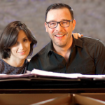 Tamar Halperin and Adreas Scholl in front of a piano